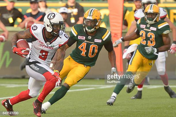 Ottawa's Travon Van challenged by Edmonton's Deon Lacey during CFL game Edmonton Eskimos vs Ottawa Redblacks at The Brick Field at Commonwealth...