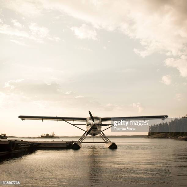 DHC 3 Otter floatplane docked on lake