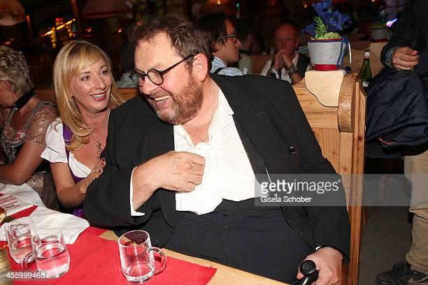 Ottfried Fischer and his girlfriend Simone Brandlmeier attend the 'GoldStar TV Wiesn' during Oktoberfest at Weinzelt Theresienwiese on September 23...