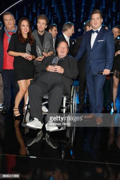 Ottfried Fischer poses with the Honorary Award beside the other Award winners as Carolin Kebekus Luke Mockridge and Hape Kerkeling and Chris Tall...