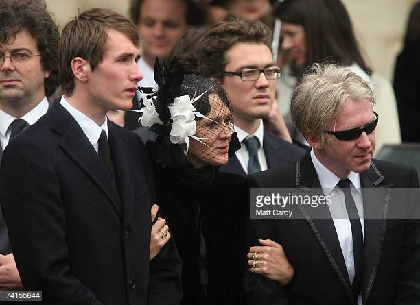 Ottis Ferry and designer Philip Treacy are comforted by Ottis's mother Lucy Ferry at the funeral service for fashion stylist Isabella Blow at...