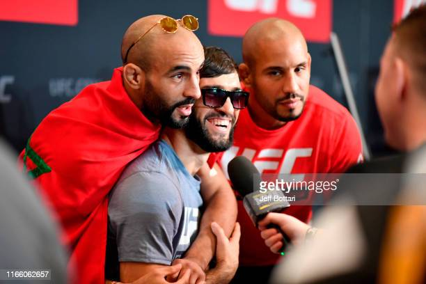 Ottman Azaitar of Germany interacts with Zubaira Tukhugov of Russia and Abu Azaitar during the UFC 242 Ultimate Media Day at the Yas Hotel on...