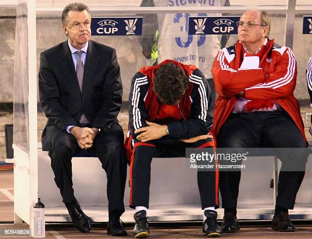 Ottmar Hitzfeld , head coach of Bayern Munich, assistant coach Michael Henke and manager Uli Hoeness look dejected during the UEFA Cup semi final 2nd...