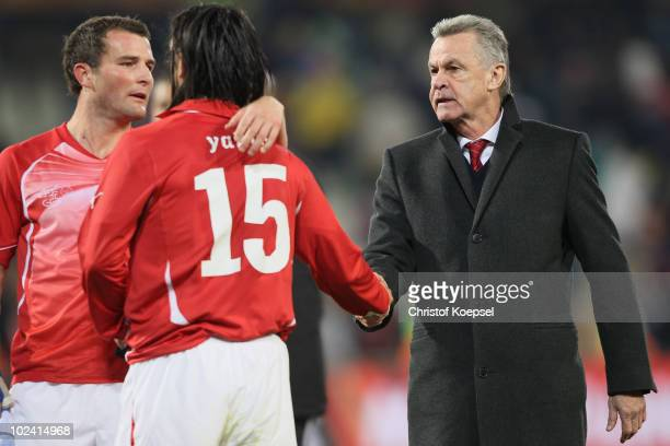 Ottmar Hitzfeld head coach of Switzerland consoles dejected Hakan Yakin of Switzerland after a goalless draw and elimination from the tournament...