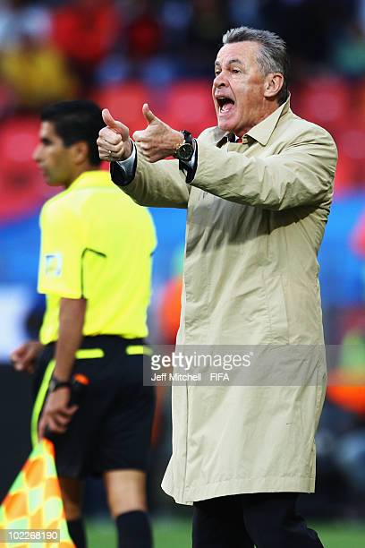 Ottmar Hitzfeld head coach of Switzerland gestures during the 2010 FIFA World Cup South Africa Group H match between Chile and Switzerland at Nelson...