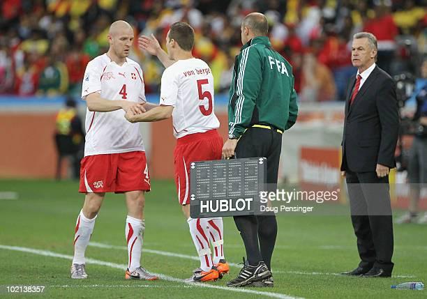 Ottmar Hitzfeld head coach of Switzerland substitutes Philippe Senderos for Steve von Bergen of Switzerland during the 2010 FIFA World Cup South...