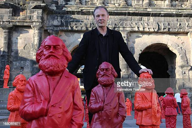 Ottmar Hoerl the artist stands between some of the 500 one meter tall statues of German political thinker Karl Marx on display on May 5 2013 in Trier...