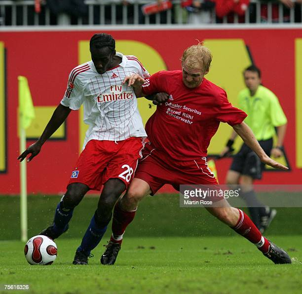 Otto Addo of Hamburg and Florian Ruehl of Felde fight for the ball during the friendly match between TUS Felde and Hamburger SV at Holstein Stadion...
