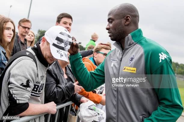 Otto Addo signs a fan shirt after a training session of Borussia Moenchengladbach at BorussiaPark on July 02 2017 in Moenchengladbach Germany