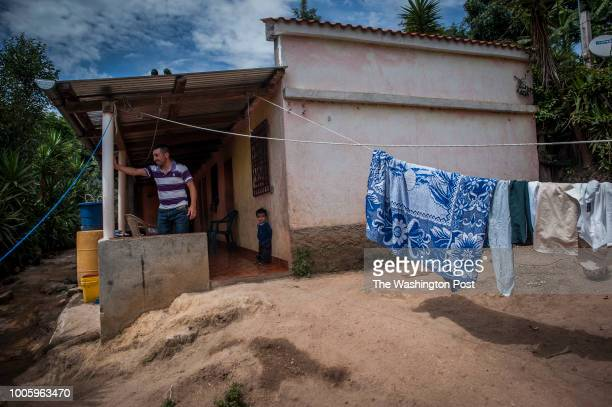 Otto Albizures and his younger son Dylan at the entrance of his house in Las Nueces village Santa Rosa Otto Albizurez and his son Ervin left their...