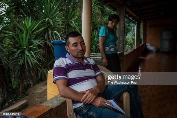 Otto Albizures sits at the front yard of his house in Las Nueces village Santa Rosa In the background his wife Elvia Mariela Marroquin 31 Otto...