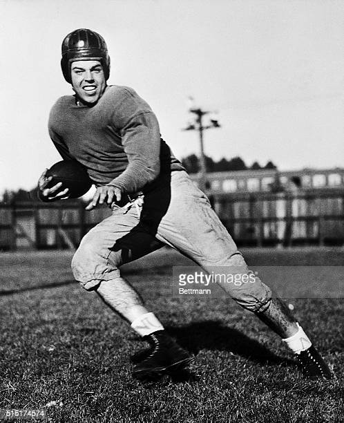 Otto Graham, football player for Northwestern University, is shown in a pose as if he's running with the football.