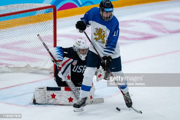 Otto Hokkanen of Finland masks Goalkeeper Dylan Silverstein of United States view during Men's 6Team Tournament Preliminary Round Group A Game...