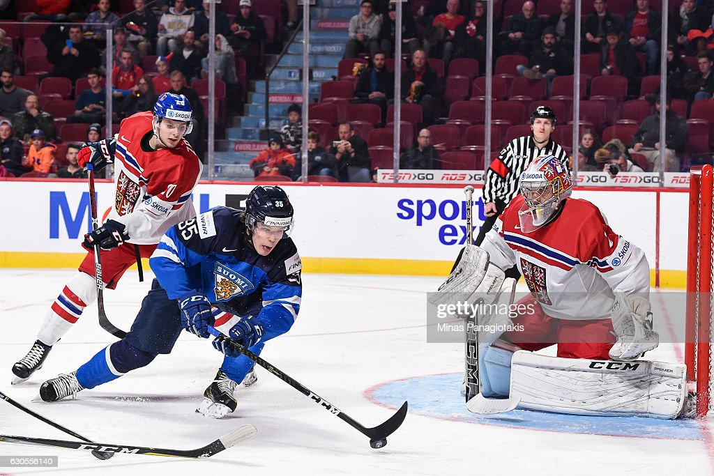 Otto Koivula #35 of Team Finland collects the rebound near goaltender Jakub Skarek #2 of Team Czech Republic during the IIHF World Junior Championship preliminary round game at the Bell Centre on December 26, 2016 in Montreal, Quebec, Canada.