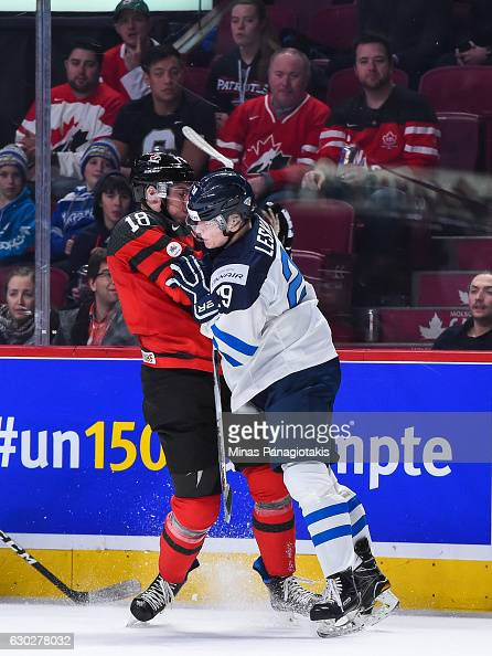 Otto Leskinen of Team Finland checks Pierre-Luc Dubois of ...