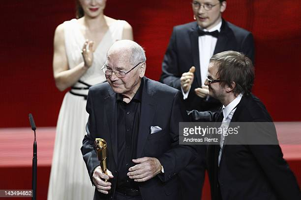 """Otto Mellies seen onstage after winning the award as """"Best Male Supporting Actor"""" at the Lola - German Film Award 2012 -Show at Friedrichstadt-Palast..."""