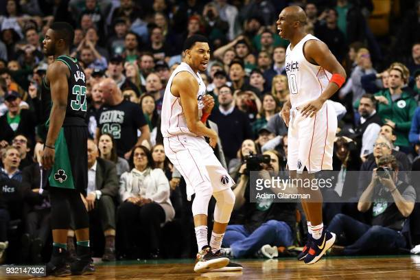 Otto Porter Jr #22 and Jodie Meeks of the Washington Wizards react in the fourth quarter of a game against the Boston Celtics at TD Garden on March...