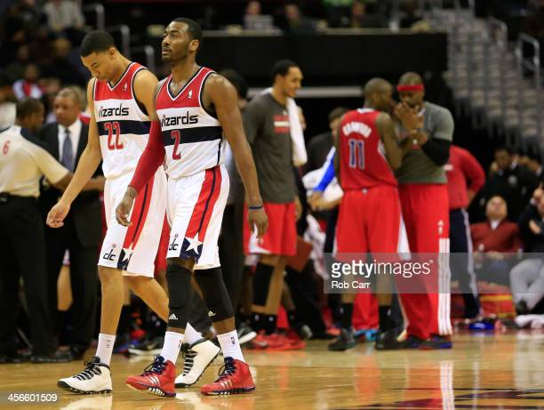 Otto Porter Jr #22 and John Wall of the Washington Wizards walk off the floor during a second half timeout against the Los Angeles Clippers at...