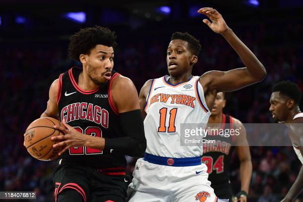 Otto Porter Jr #22 of the Chicago Bulls drives against Frank Ntilikina of the New York Knicks in the second half at Madison Square Garden on October...