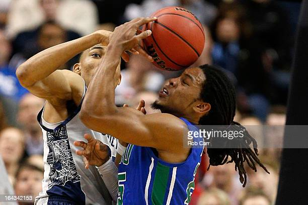 Otto Porter Jr #22 of the Georgetown Hoyas fights for the ball in the first half against Sherwood Brown of the Florida Gulf Coast Eagles during the...