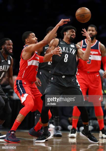 Otto Porter Jr #22 of the Washington Wizards and Spencer Dinwiddie of the Brooklyn Nets battle for the ball during their game at Barclays Center on...