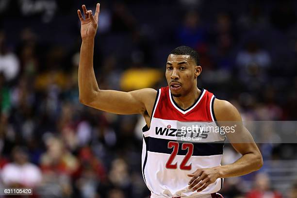 Otto Porter Jr #22 of the Washington Wizards celebrates after hitting a three pointer against the Minnesota Timberwolves at Verizon Center on January...