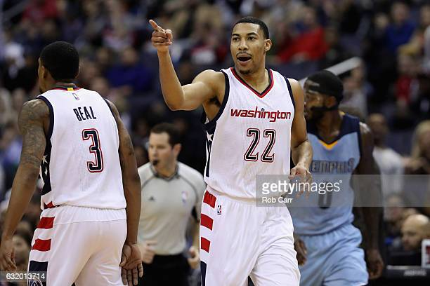 Otto Porter Jr #22 of the Washington Wizards celebrates after hitting a three point shot against the Memphis Grizzlies at Verizon Center on January...