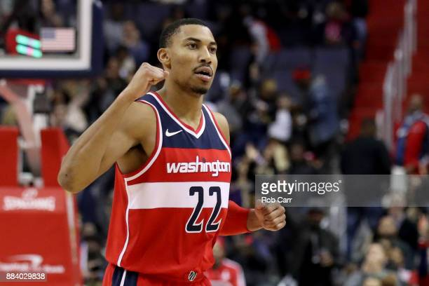 Otto Porter Jr #22 of the Washington Wizards celebrates in the fourth quarter against the Detroit Pistons at Capital One Arena on December 1 2017 in...