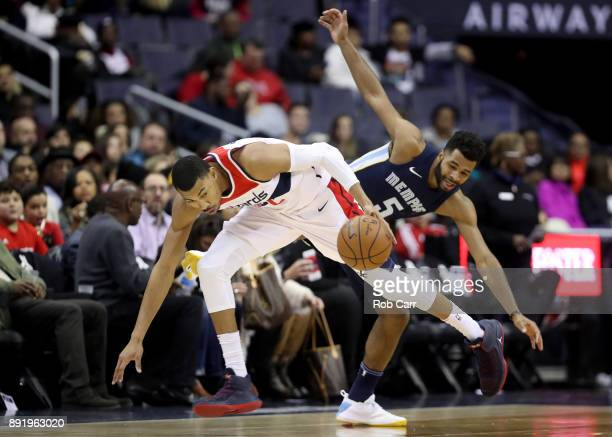 Otto Porter Jr #22 of the Washington Wizards dribbles past Andrew Harrison of the Memphis Grizzlies in the second half at Capital One Arena on...