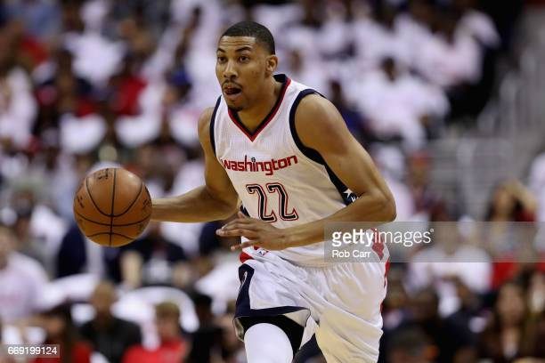 Otto Porter Jr #22 of the Washington Wizards dribbles the ball against the Atlanta Hawks in Game One of the Eastern Conference Quarterfinals during...