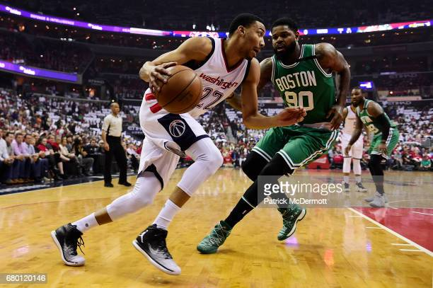 Otto Porter Jr #22 of the Washington Wizards dribbles the ball against Amir Johnson of the Boston Celtics in the first quarter in Game Four of the...