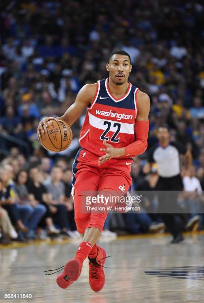Otto Porter Jr #22 of the Washington Wizards dribbles the ball against the Golden State Warriors during their NBA basket ball game at ORACLE Arena on...