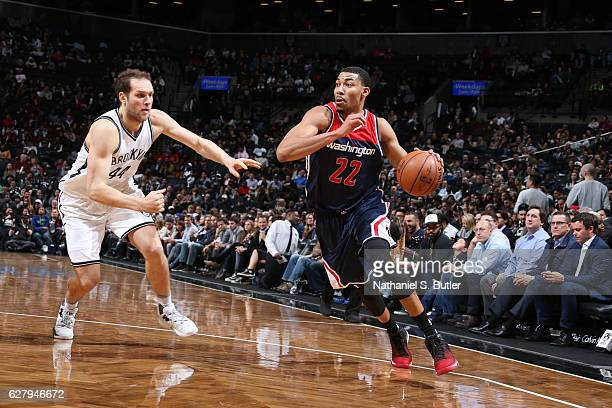Otto Porter Jr #22 of the Washington Wizards drives to the basket against Bojan Bogdanovic of the Brooklyn Nets during the game on December 5 2016 at...