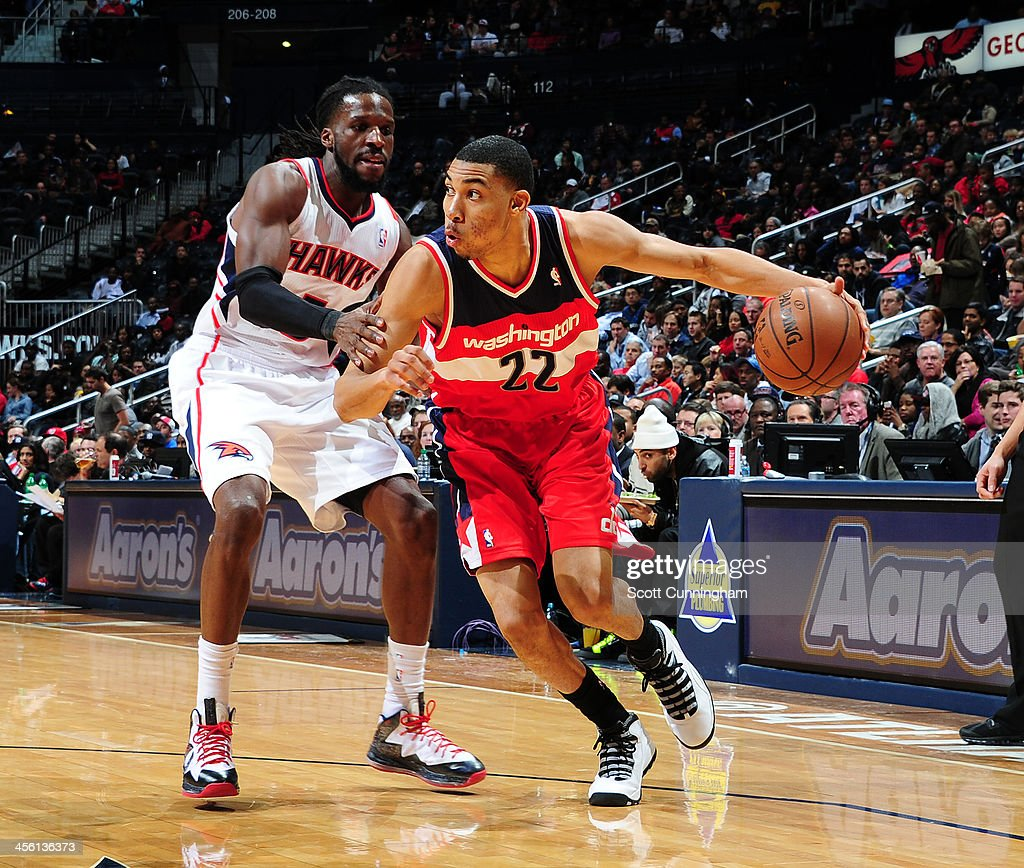 Otto Porter Jr. #22 of the Washington Wizards drives to the basket against the Atlanta Hawks on December 13, 2013 at Philips Arena in Atlanta, Georgia.