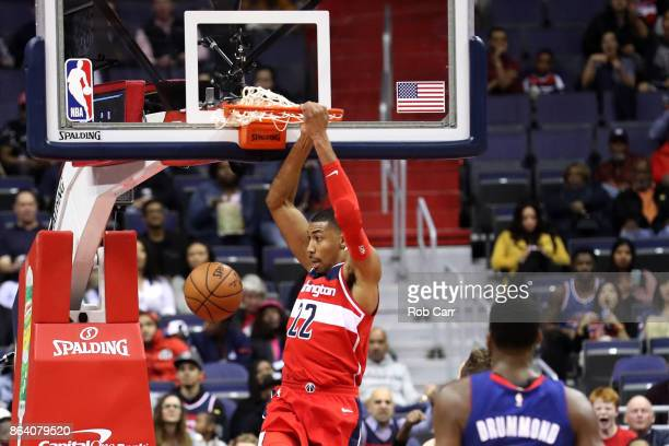 Otto Porter Jr #22 of the Washington Wizards dunks the ball against the Detroit Pistons in the first half at Capital One Arena on October 20 2017 in...