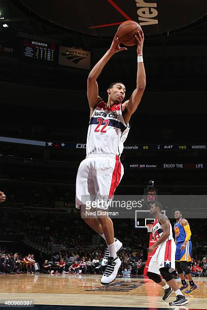 Otto Porter Jr #22 of the Washington Wizards grabs the rebound against the Golden State Warriors at the Verizon Center on January 5 2014 in...