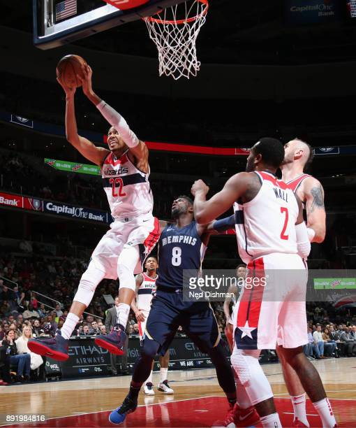 Otto Porter Jr #22 of the Washington Wizards grabs the rebound against the Memphis Grizzlies on December 13 2017 at Capital One Arena in Washington...