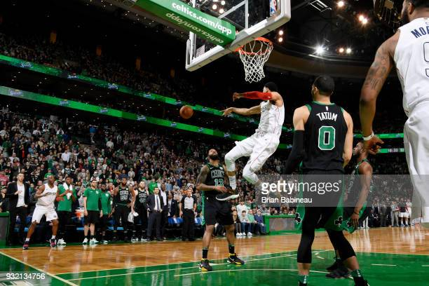 Otto Porter Jr #22 of the Washington Wizards passes the ball against the Boston Celtics on March 14 2018 at the TD Garden in Boston Massachusetts...
