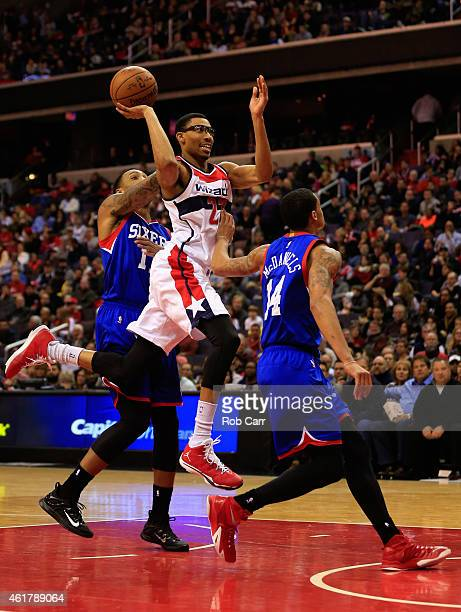Otto Porter Jr #22 of the Washington Wizards puts up a shot between Malcolm Thomas and KJ McDaniels of the Philadelphia 76ers during the second half...