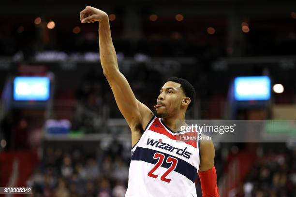 Otto Porter Jr #22 of the Washington Wizards shoots against the Miami Heat during the second half at Capital One Arena on March 6 2018 in Washington...