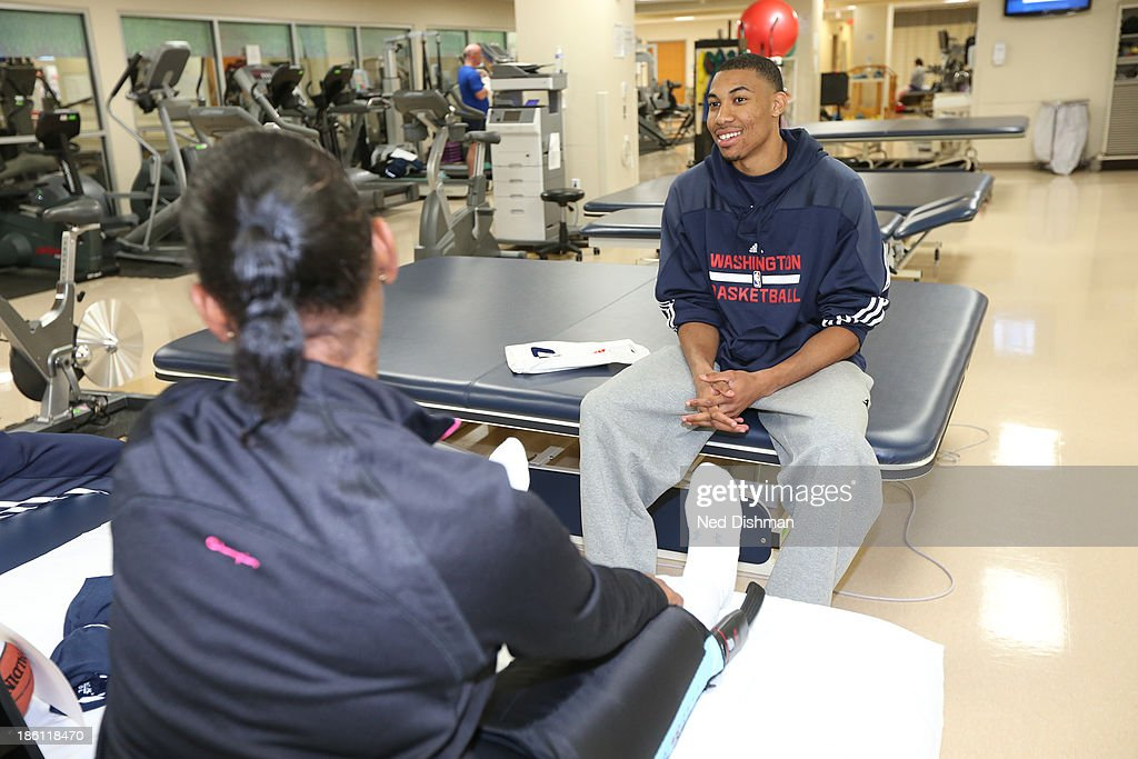 Otto Porter Jr #22 of the Washington Wizards speaks with a patient during a visit to Walter Reed Medical Center on October 25, 2013 in Washington, DC.