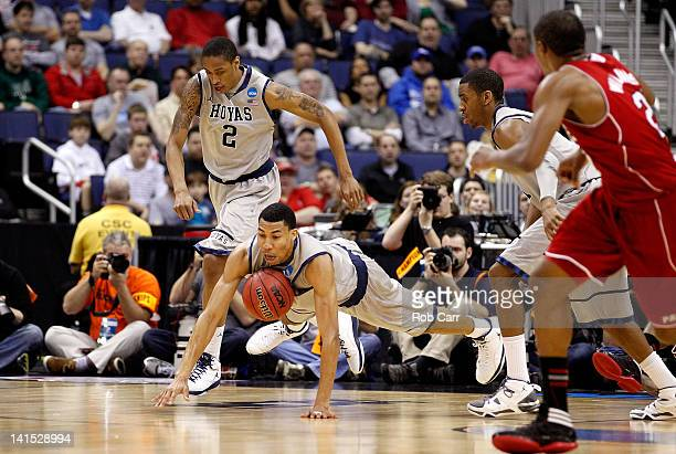 Otto Porter of the Georgetown Hoyas dives for a loose ball against the North Carolina State Wolfpack in the first half during the third round of the...