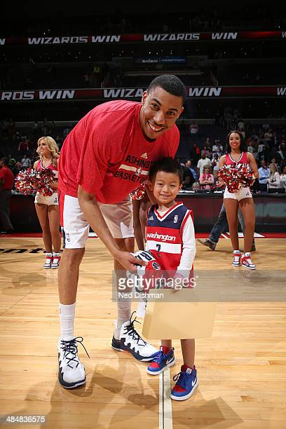 Otto Porter of the Washington Wizards exchanges his jersey with a fan after the game against the Milwaukee Bucks during the game at the Verizon...