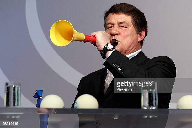 Otto Rehhagel, head coach of the Greece national football team, blows into a vuvuzela during the DFB Live at the Steigenberger Airport hotel on May...