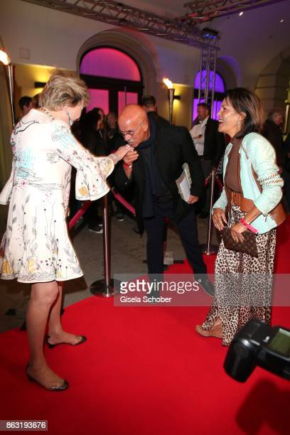 Otto Retzer gives a kiss on the hand of Dr Antje Katrin Kuehnemann and his wife Shirley Retzer during the musical premiere of 'Santa Maria' at...