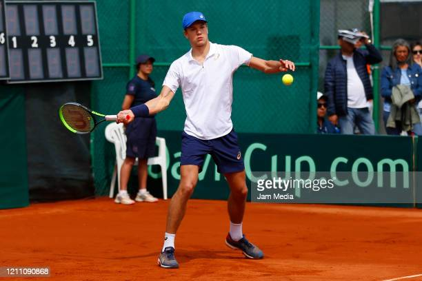 Otto Virtanen of Finland returns the ball as part of day 2 of Davis Cup World Group I Play-offs at Club Deportivo La Asuncion on March 7, 2020 in...