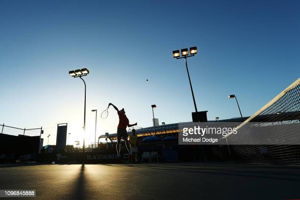 Otto Virtanen of Finland smashes the ball next to Rinky Hijikata of Australia who compete in their first round Junior Boys Doubles match against...