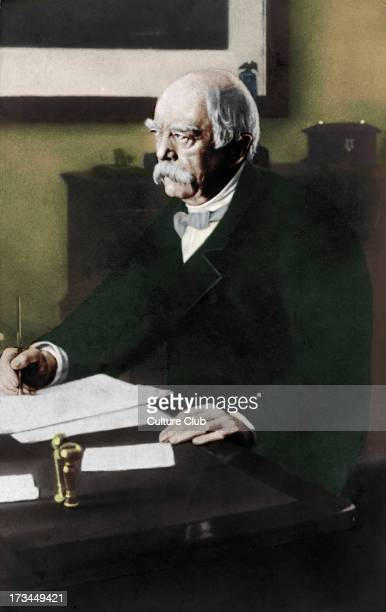 Otto von Bismarck at his desk. Prussian politician 1815-1898. Became leader of Germany after unification.