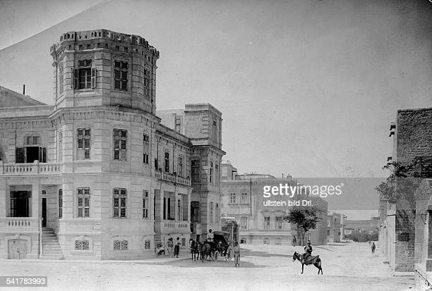 Ottoman Empire Allepo Horsedrawn carrige in front of the building of the 'Baghdad Railway' Photographer American Colony Published by 'Berliner...