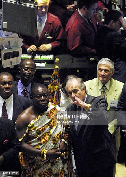 Otumfuo Osei Tutu II King of Ashanti Kingdom of Ghana tours the trading floor of the New York Stock Exchange with NYSE Senior VicePresident Alain...